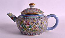 A CHINESE FAMILLE ROSE TEAPOT AND COVER Jiaqing mark and possibly of the period, painted with flowers and vines. 6.75ins wide.