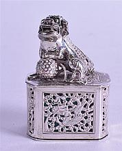 AN UNUSUAL LATE 19TH CENTURY CHINESE EXPORT SILVER INCENSE BURNER AND COVER modelled with a recumbent dog of foe, the inner sleeve unusually enamelled. 63 grams. 6 cm high.