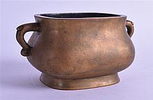 A CHINESE TWIN HANDLED BRONZE CENSER bearing Xuande marks to base. 989 grams. 14 cm overall, internal diameter 8 cm.