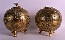 A PAIR OF 19TH CENTURY CHINESE BRONZE INCENSE BURNERS AND COVERS of globular form, decorated with figures on horseback. 8.75ins high.