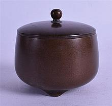 A CHINESE BRONZE CENSER AND COVER bearing Xuande marks to base. 7.25 cm diameter.
