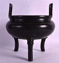 AN 18TH/19TH CENTURY CHINESE TWIN HANDLED BRONZE CENSER with high loop handles, the feet mounted with buddhistic mask heads. 1974 grams. 7Ins wide overall, 5.5ins internal diameter.