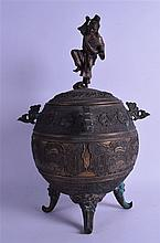 A GOOD 19TH CENTURY JAPANESE MEIJI PERIOD BRONZE CENSER AND COVER modelled with a male grabbing a toad attached to his head. 44 cm x 30 cm.