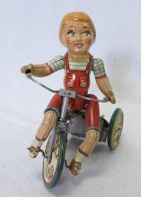 Kiddy Cyclist Tin Litho Wind Up Toy. Unique Art Mfg Co