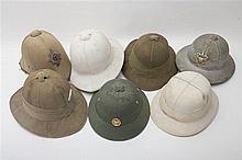 Set of seven tropical helmets - England and USA