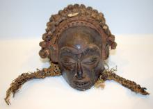19thc african tribal art mask of small proportions with elaborate braided hair indset with
