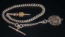 SOLID SILVER GRADUATING ALBERT CHAIN WITH T BAR, WATCH KEY AND FOB MEDAL, EACH LINK STAMPED, LENGTH APPROX 15 INCHES, TOTAL WEIGHT APPROX 59.1G