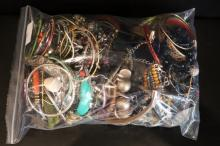 LARGE BAG CONTAINING A QUANTITY OF COSTUME JEWELLERY