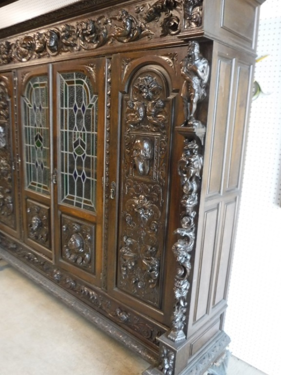 large walnut bookcase with 2 leaded glass doors