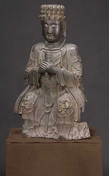 A Chinese figure of a seated deity, Ming dynasty
