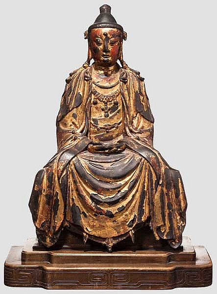 A Chinese gilt-bronze figure of Guanyin, Ming period