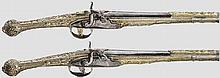A pair of silver-mounted and gilt percussion pistols, Boka Kotorska, 19th century