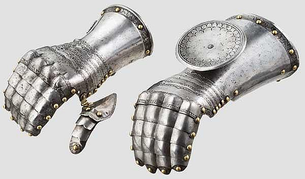 A pair of German gauntlets with etched decoration, circa 1540