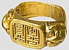 A Chinese golden presentation ring, circa 1900