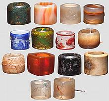 14 archer's rings in glass, hardstone, amber and agate, China, Qing dynasty