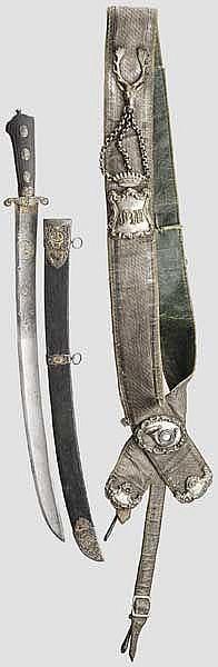 Eisengeschnittene, teilvergoldete Jagdplaute mit Gehänge, deutsch um 1800