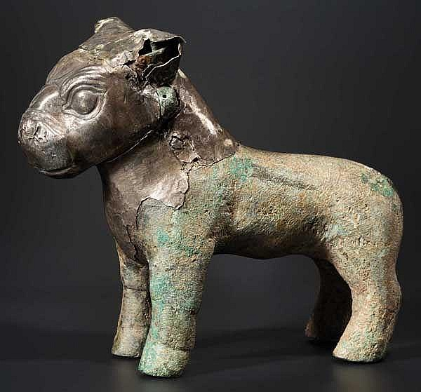 A silver covered bronze bull sculpture, 16th - 15th century B.C.