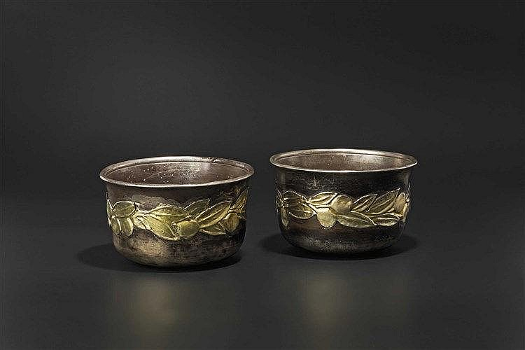 Two late Hellenistic/early Roman silver cups with flower decoration, 1st century B.C. - 1st century A.D.