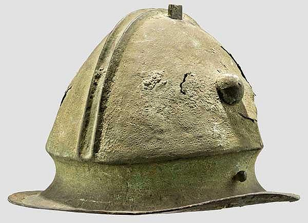 A bossed bronze helmet with offset rim and two ridges, 6th century B.C.
