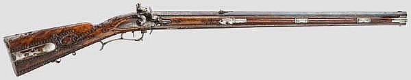 A significant silver-mounted deluxe turn-over flintlock rifle, Andreas Hauer in Würzburg, dated 1795