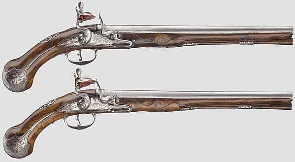A pair of long Italian flintlock pistols, circa 1710