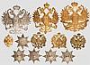 Sieben Doppeladlerembleme, fünf Gardesterne für Kopfbedeckungen und zehn Auflagen für Epauletten und Schulterstücke, Russland, 1880 - 1915