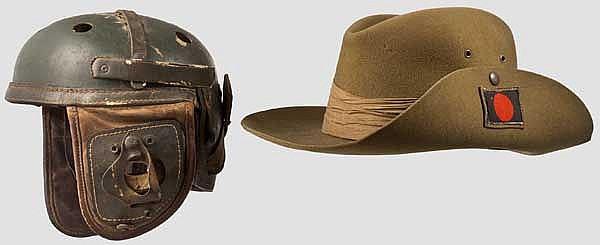 Panzerhelm und Hut aus dem Zweiten Weltkrieg