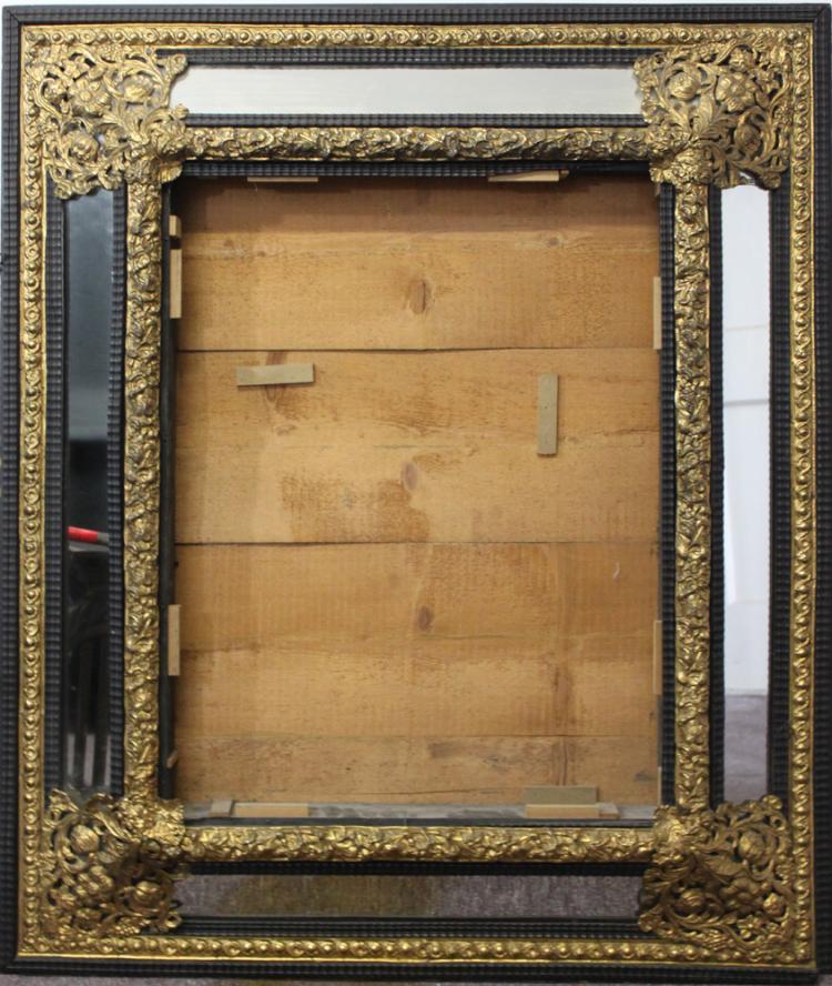 A Dutch Ebonized and Gilt Metal Mirror Frame, 19th Century