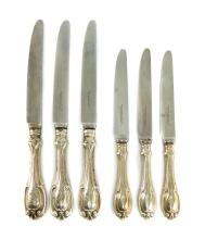A large quantity of Antique Sterling Silver dinner and dessert knives