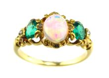 An antique opal, emerald & diamond ring