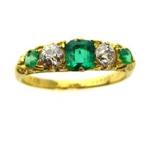 An antique Edwardian emerald and diamond five stone dress ring
