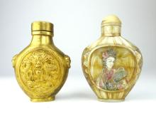 A Chinese gilt metal snuff bottle and an engraved and polychromed mother-of-pearl snuff bottle, 8cm high. (2)