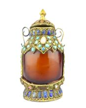 A Sino-Tibetan gilt metal mounted agate snuff bottle studded with cabouchon stones, 10cm high.