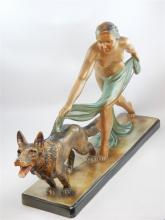 Art Deco style painted plaster figure of a lady with Alsatian, 72cm l.