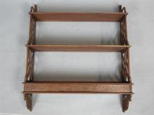 Early 20th C waterfall wall shelves, mahogany with cockpen sides, three dra