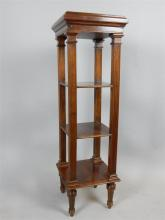 A French walnut whatnot of slender design, with shelving and turned legs, c