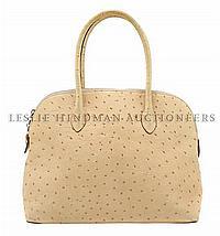 *An Escada Cream Ostrich Bolide Style Bag. 15 x 8 inches.