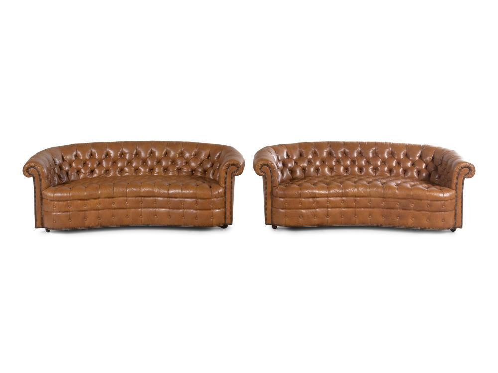 A Pair of Faux Leather Upholstered Chesterfield Sofas
