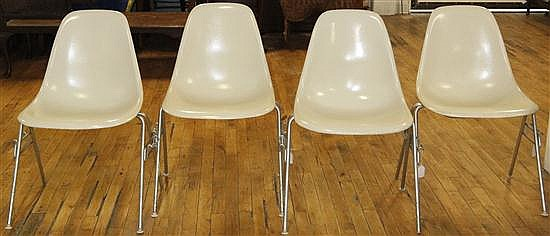 * A Group of Eight Charles and Ray Eames Chairs, Height 31 inches.