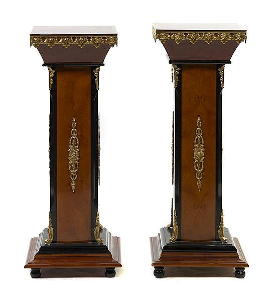 A Pair of Neoclassical Style Gilt Metal Mounted Burlwood and Parcel Ebonized Pedestals, Height 38 1/4 inches.