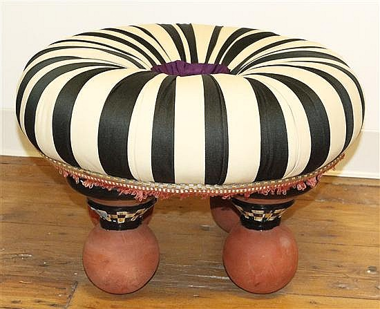 * A Mackenzie Childs Upholstered Stool, Height 14 1/2 x diameter 21 inches.