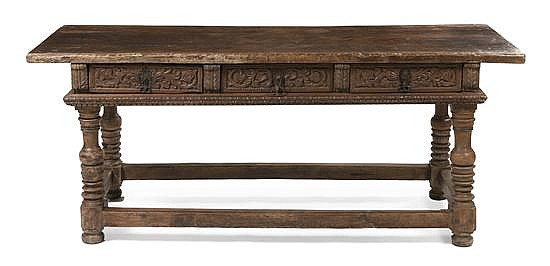 * A Spanish Baroque Carved Walnut Console Table, Height 33 x width 80 x depth 30 1/4 inches.