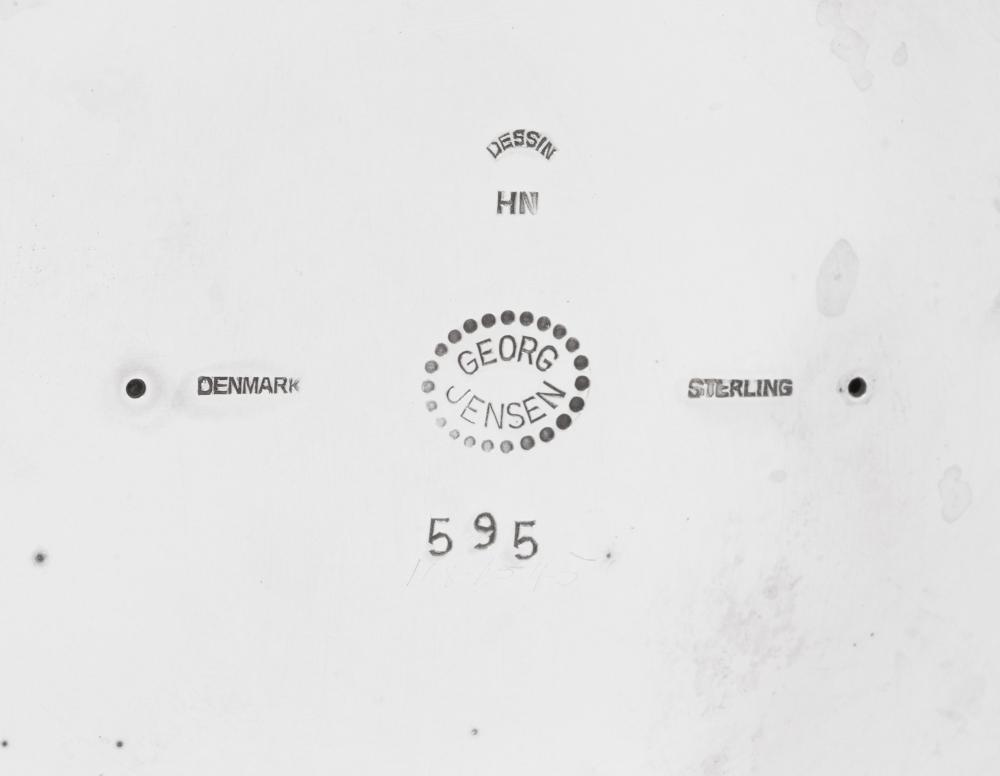A Pair of Harald Nielsen for Georg Jensen Silver Three-Light Candelabra