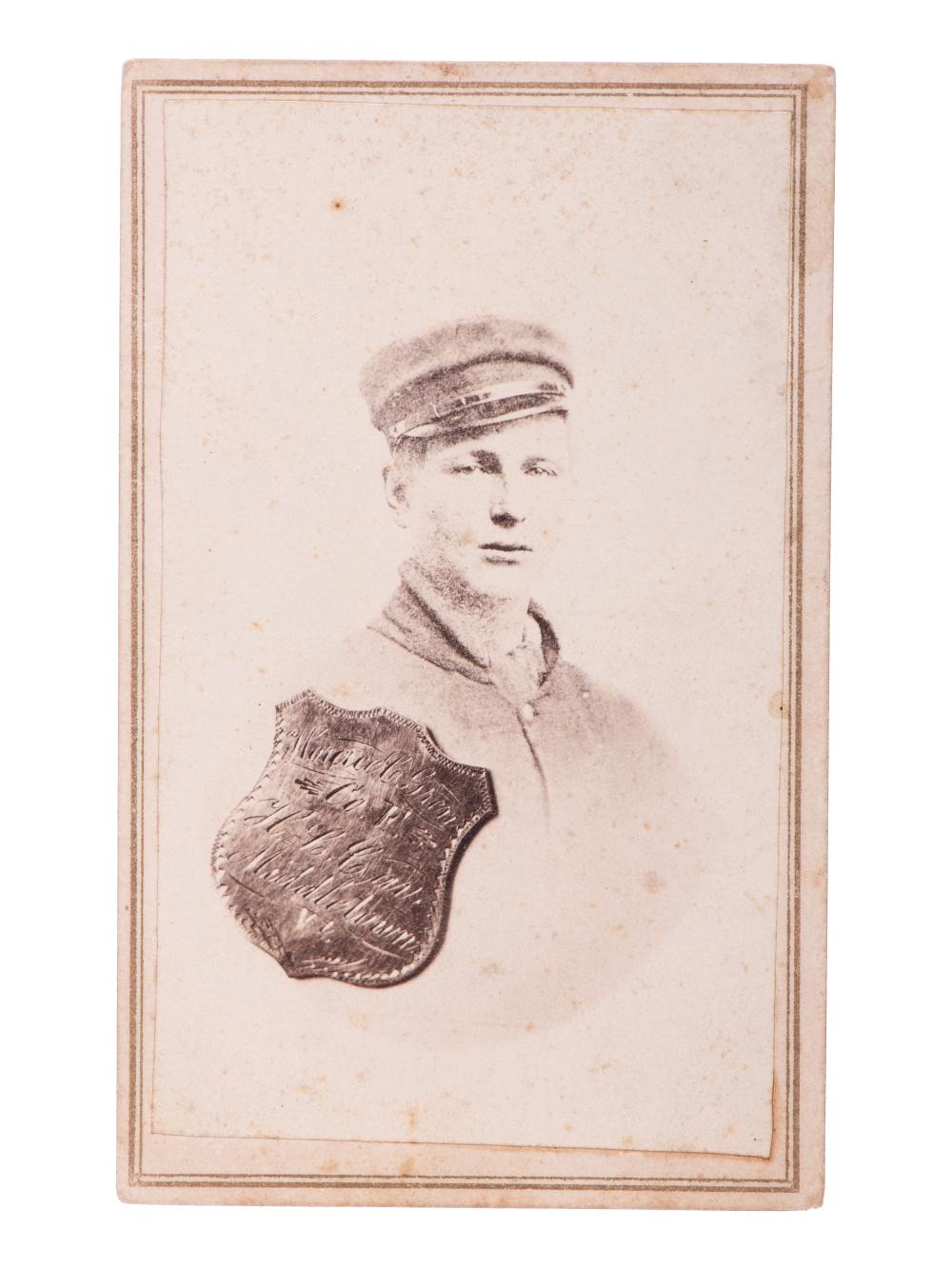 """SHELL, J.H., photographer. CDV portrait of Private Horace C. Green, 2nd New York Cavalry, """"Harris Light Cavalry,"""" with superimposed ID shield. Findlay, OH: [ca 1860s]."""