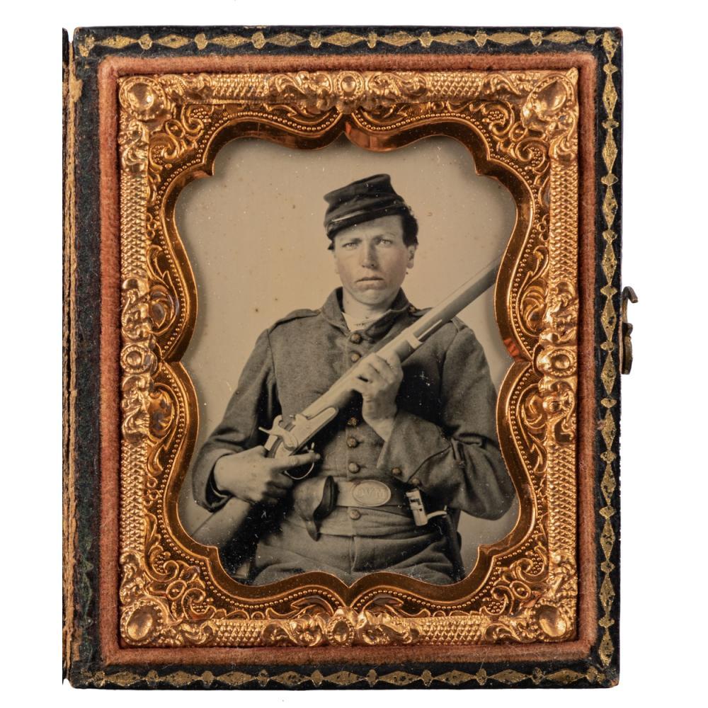 "Ninth plate ambrotype of double-armed Ohio volunteer infantryman wearing ""OVM"" belt plate."