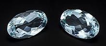 Aquamarin-Paar, zus. 15,42 ct oval fac., in einem feinen, leicht grünstichigen Hellblau, sehr, sehr kleine innere Merkmale, 17,10 x 11,30 x 6,56 und 17,14 x 10,80 x 7,35 mm, natürlich, mit ID-Card