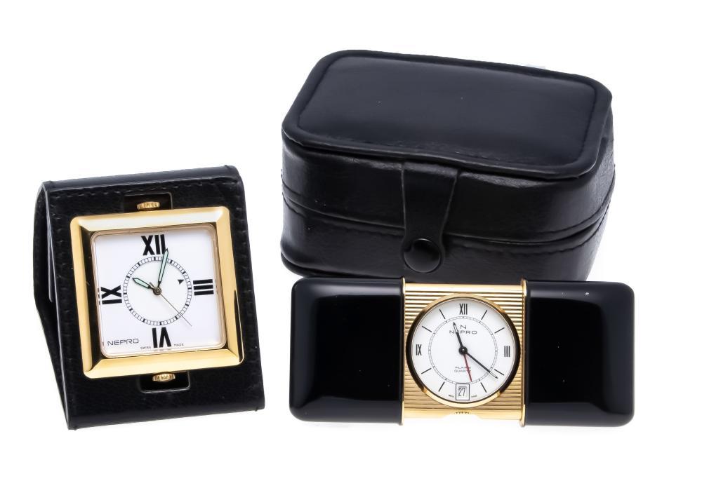 2 small travel alarm clocks N