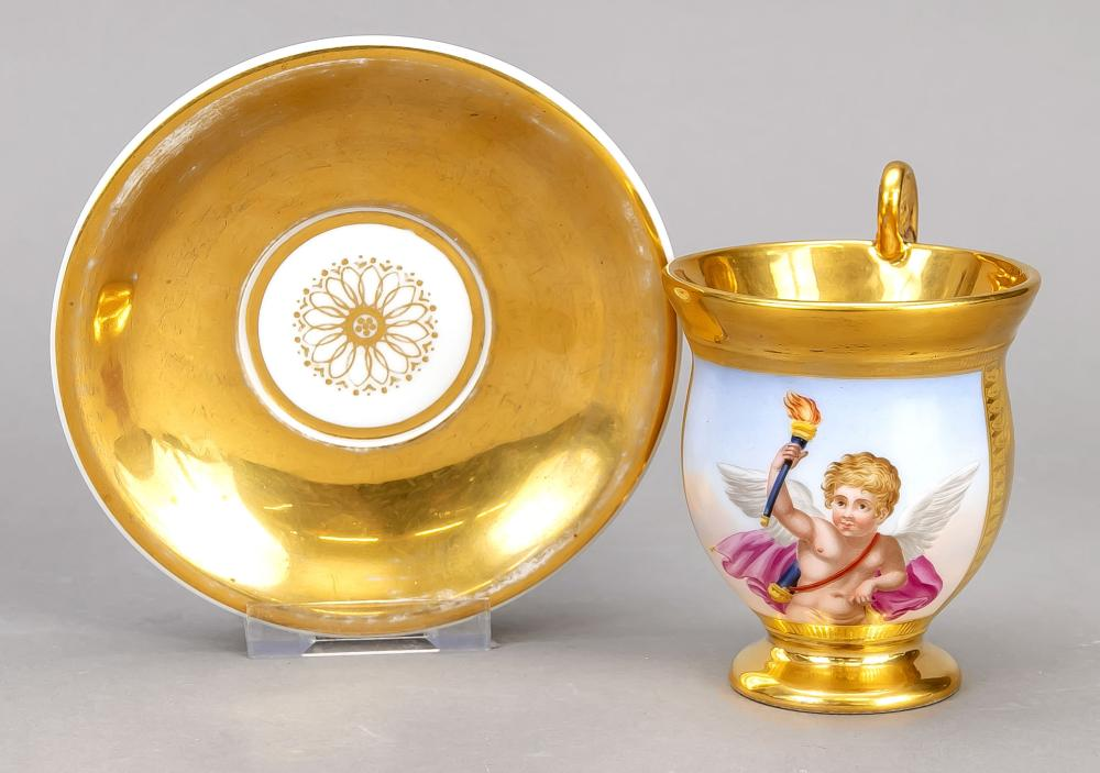 A picture cup with a saucer, w