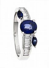 Saphir-Brillant-Ring WG 750/000 mit einem oval fac. Saphir 6,5 x 5 mm in ex