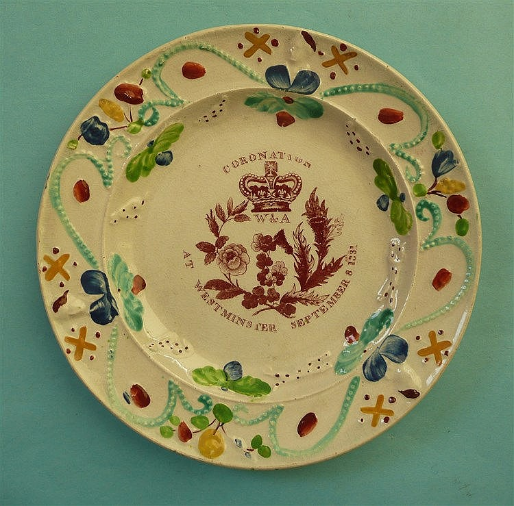 1831 Coronation: a colourful plate with moulded decoration printed in iron